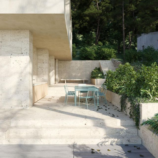 Casa Tamariu. The terraces and the facade of the first floor are cladded with natural stone. Equal treatment of all surfaces makes the plinth of the villa appear to be gouged out of the rocky mountains. Different types of outdoor spaces are aligned along the villa and separated by subtle height differences. The outdoor spaces are bordered by a planter that acts as a railing and green planter at the same time. The outdoor terrace is complimented by an outdoor kitchen, which is integrated into the facade.  @keizer_koopmans